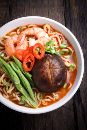 instant noodle: Hot and spicy instant noodle isolated on the dark color background