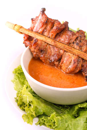 slivers: Satay is a Malaysian style kebab. It is served with a peanut sauce, and slivers of cucumbers and onions.
