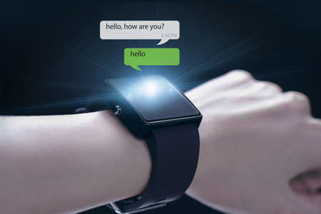 timekeeping: Hand wearing smartwatch. A smartwatch is a wearable computing device that closely resembles a wristwatch or other time-keeping device.