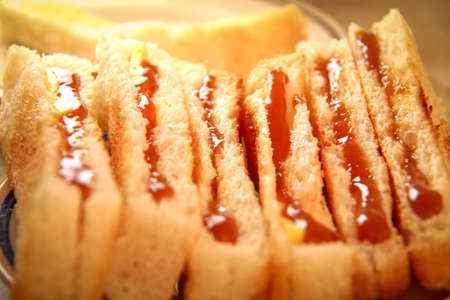 aisa: Traditional homemade toasted bread with coconut jam on plate Stock Photo