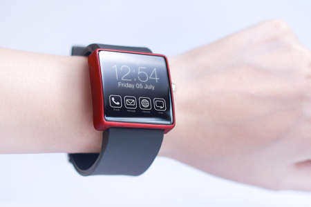 innovating: Hand wearing smartwatch. A smartwatch is a wearable computing device that closely resembles a wristwatch or other time-keeping device.