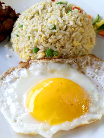 has been: Fried rice is a Chinese dish of steamed rice that has been stir-fried in a wok Stock Photo