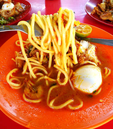 often: Mi rebus or Mee rebus is a noodle dish popular in Indonesia, Malaysia, and Singapore. It is also often called mi kuah. Stock Photo