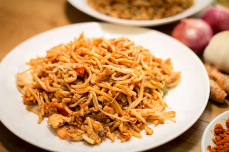 fried foods: Fried noodles are delicious and healthy dish, quick and easy to make. Chinese people usually add plenty of salt and soy sauce for extra flavor. Stock Photo