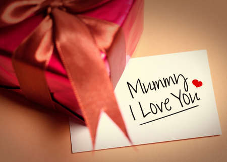 Card of mothers day and prensent box. Mothers Day is observed the second Sunday in May.