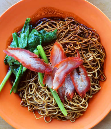 popular: Wonton noodles is a Cantonese noodle dish which is popular in asia. The dish is usually served in a hot broth, garnished with leafy vegetables, and wonton dumplings.