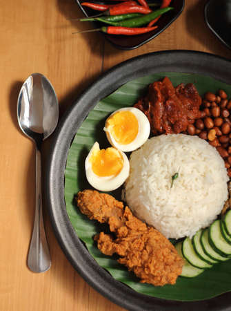 unofficial: Nasi Lemak is a commonly found food in Malaysia, Brunei and Singapore. It is also an unofficial national food in Malaysia.