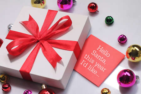 christmas gift box with greeting card wishing you wonderful memories during this joyous season