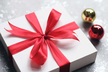 christmas gift box with bells on simple background wishing you wonderful memories during this joyous