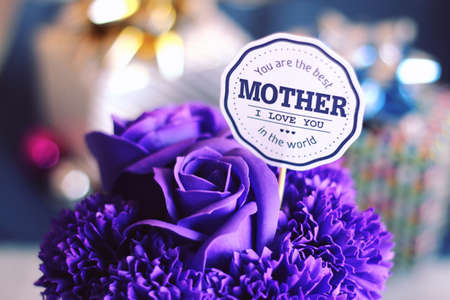 Mother's Day falls on different days depending on the countries where it is celebrated. It is held on the second Sunday of May in many countries. Archivio Fotografico - 101096351