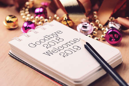 Goodbye 2018 welcome 2019 with decoration. We wish you a new year filled with wonder, peace, and meaning. Stock Photo