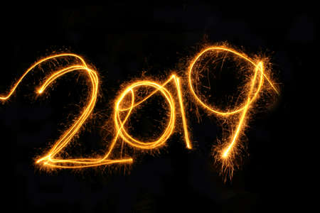 2019 written with a sparkler on a black background