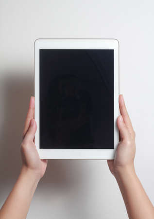 Hands showing tablet. A tablet is a wireless touch screen personal computer that is smaller than a notebook but larger than a smartphone.