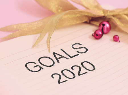Goals 2020 with colorful decoration. Discover how setting goals can bring more happiness in your life.