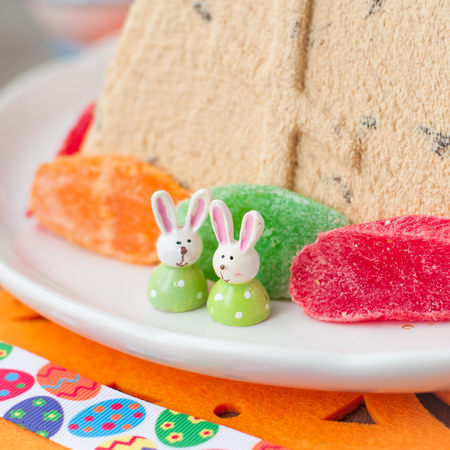 russian easter: Easter Bunnies on the Plate with Curd Paskha, Traditional Russian Easter Dessert,  copy space for your text, square