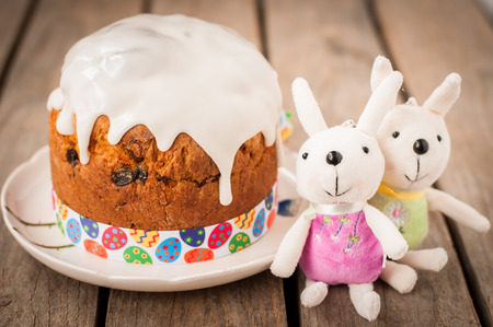 paskha: Rustic Style Kulich, Russian Sweet Easter Bread Topped with Sugar Glaze, vintage effect, copy space for your text
