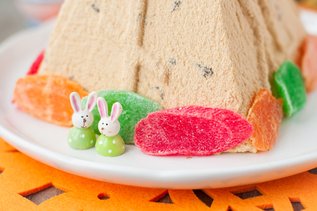 russian easter: Easter Bunnies on the Plate with Curd Paskha, Traditional Russian Easter Dessert,  copy space for your text