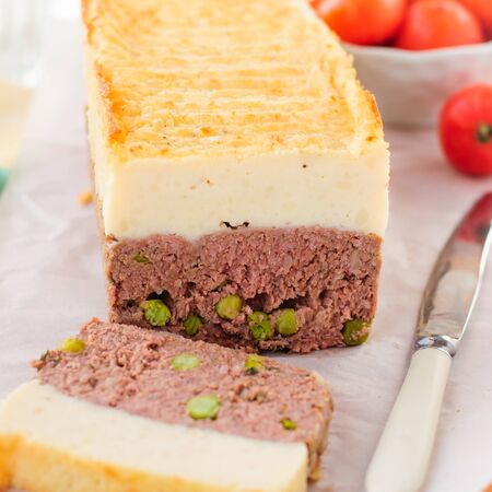 meatloaf: Beef Meatloaf with Green Peas Topped with Cheesy Mashed Potato, close up, square