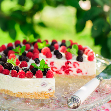 black raspberries: No-bake Fresh Raspberry Cheesecake with Red and Black Raspberries and Melissa, Summer Cake, copy space for your text, square Stock Photo