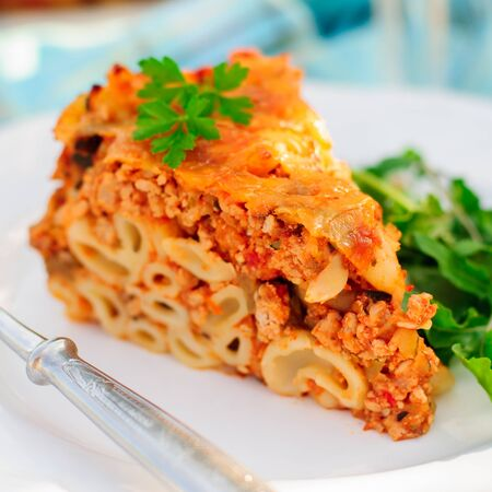 macaroni with cheese: A Piece of Bolognese Pasta Bake, Macaroni Cheese, Minced Meat and Pasta Pie, close up, square