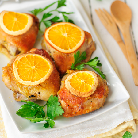 thighs: Chicken Thighs Roasted with Oranges Slices and Spices, square Stock Photo