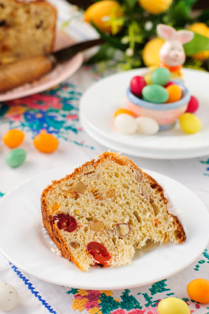 russian easter: A Slice of Kulitch (Kulich), Russian Easter Sweet Bread on Festive Embroidered Table Cloth, copy space for your text Stock Photo