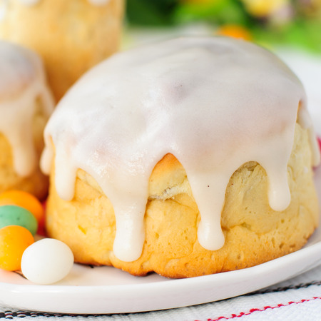 russian easter: Kulitch (Kulich), Russian Easter Bread Topped with Sugar Icing Decorated with Easter Eggs Candies, square
