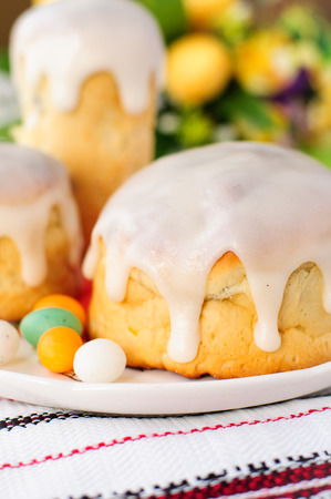russian easter: Kulitch (Kulich), Russian Easter Bread Topped with Sugar Icing Decorated with Easter Eggs Candies, copy space for your text