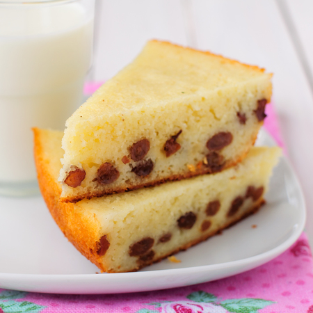 two pieces: Two Pieces of Semolina Cake with a Glass of Milk Stock Photo