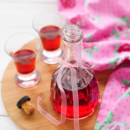 liqueur bottle: A Bottle and Two Shots of Homemade Raspberry Liqueur