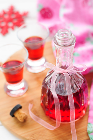 A Bottle and Two Shots of Homemade Raspberry Liqueur