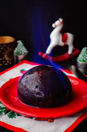 rum cake: A Christmas pudding with burning brandy topping Stock Photo