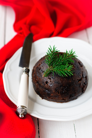 rum cake: Christmas Pudding on a White Plate