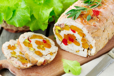 Baked turkey roll stuffed with dried apricots, cherries and pistachios
