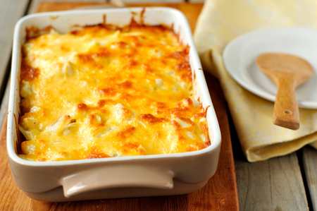A baked casserole topped with melted cheese
