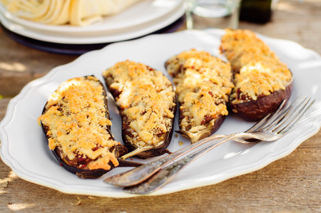 crust: Meat and Tomato Stuffed Eggplant Halves with Cheese Crust, selective focus on the middle eggplant crust Stock Photo