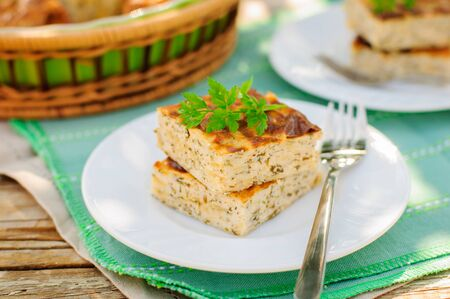 dill and parsley: Savory Cheesecake (Cottage Cheese Bake) with Herbs (Dill, Parsley and Chives), copy space for your text Stock Photo