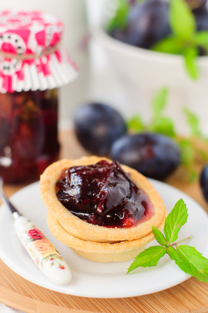 orange tart: Dessert Plum, Orange and Mint Jam in Small Tart Shells (Tartlets), copy space for your text
