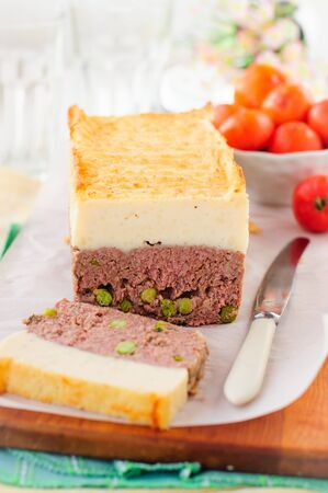 meatloaf: Beef Meatloaf with Green Peas Topped with Cheesy Mashed Potato, copy space for your text