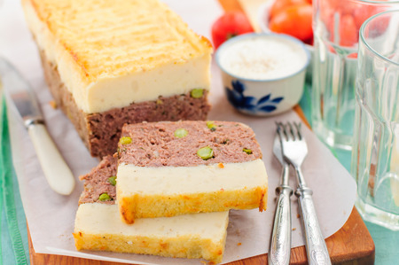 meatloaf: Beef Meatloaf with Green Peas Topped with Cheesy Mashed Potato Stock Photo