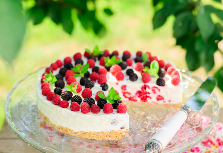 black raspberries: No-bake Fresh Raspberry Cheesecake with Red and Black Raspberries and Melissa, Summer Cake, copy space for your text
