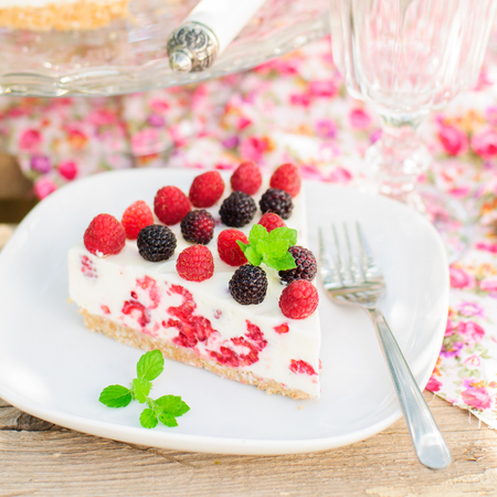 black raspberries: A Piece of No-bake Fresh Raspberry Cheesecake with Red and Black Raspberries and Melissa, Summer Cake, square