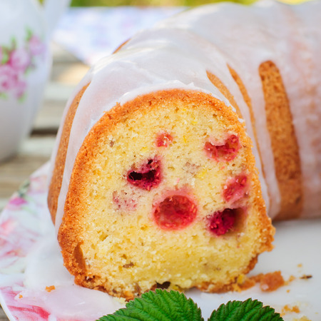caraway: Summer Lemon and Caraway Seed Bundt Cake with Raspberries Topped with Sugar Glaze, close up, square