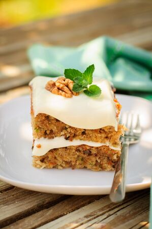 walnut cake: A Piece of Moist Zucchini and Walnut Cake with Cream Cheese Frosting, copy space for your text