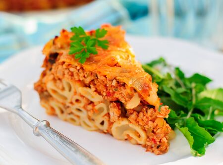 minced pie: A Piece of Bolognese Pasta Bake, Macaroni Cheese, Minced Meat and Pasta Pie, close up, copy space for your text Stock Photo