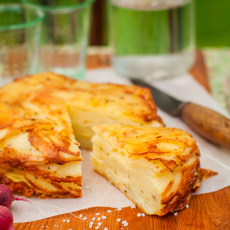 upside down: Summer Upside Down Layered Potato Bake (Cake), square Stock Photo