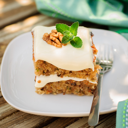 walnut cake: A Piece of Moist Zucchini and Walnut Cake with Cream Cheese Frosting, square