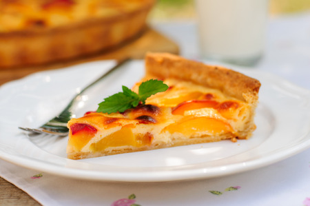 A Slice of Peach and Sour Cream Custard Pie Stock Photo