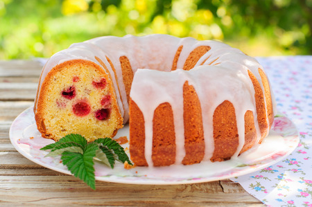 caraway: Summer Lemon and Caraway Seed Bundt Cake with Raspberries Topped with Sugar Glaze