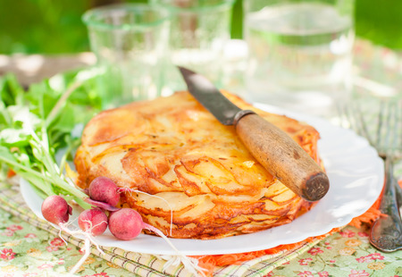 upside down: Summer Upside Down Layered Potato Bake (Cake) Stock Photo